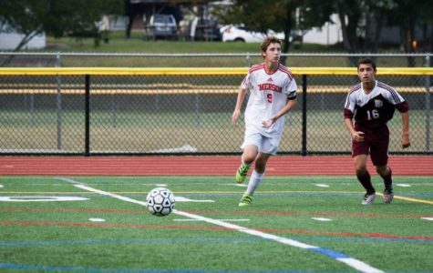 Senior soccer player breaks two school records